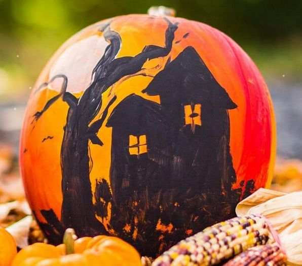 haunted house silhouette on a pumpkin