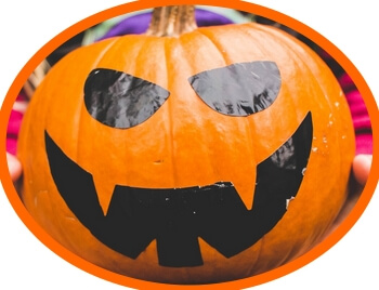 simple pumpkin face made from adhesive cut-outs