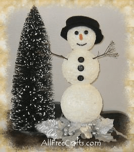 shimmering snowman made with styrofoam balls