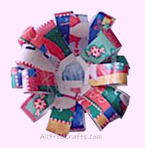 continuing construction of wrapping paper bow