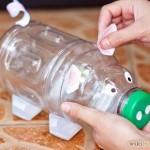 decorating a bottle piggy bank