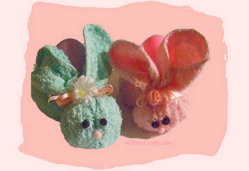 two washcloth bunnies - one green and one pink
