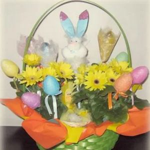 easter basket with eggs bunnies and daisies
