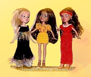 three crocheted outfits for ten inch dolls