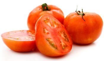 three tomatoes with one cut in half