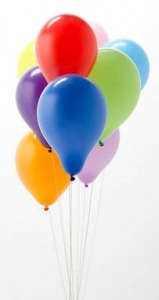 brightly colored bunch of balloons on strings