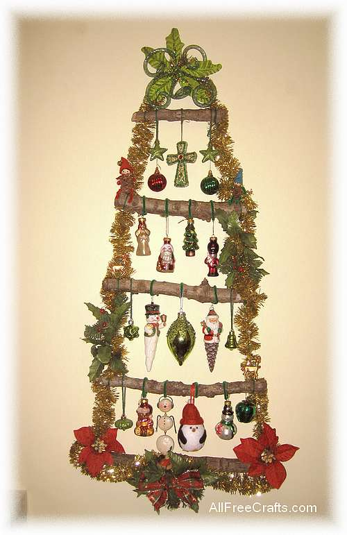 This homemade Christmas wall tree, made from natural tree branches and