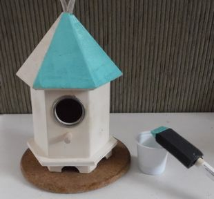painting a wooden bird house