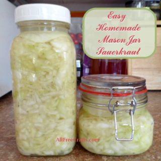two mason jars of easy homemade sauerkraut