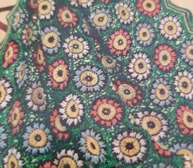 closeup details of colonial charm afghan pattern motifs